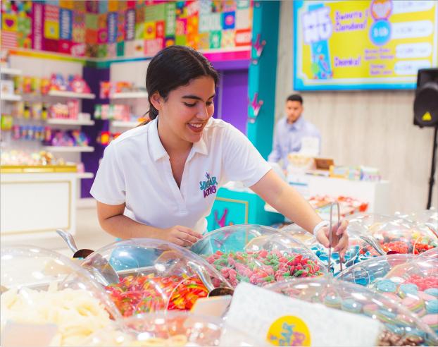 Sugar King Employee serving candy
